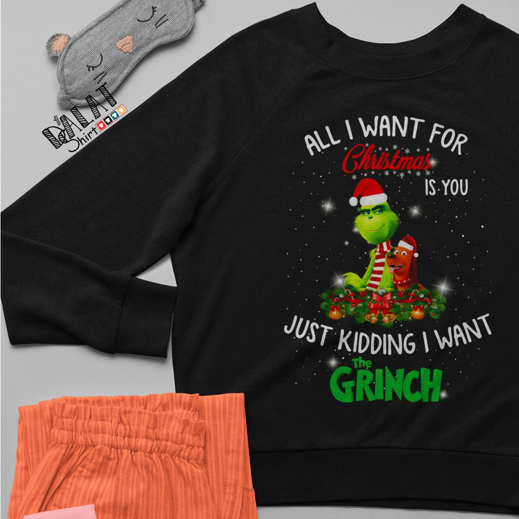 All I want for Christmas is you just kidding I want The Grinch sweater