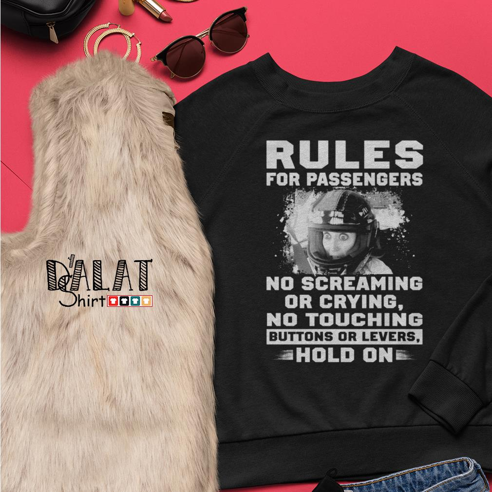 Rules for passengers no screaming or crying no touching buttons or levers hold on Ladies tee